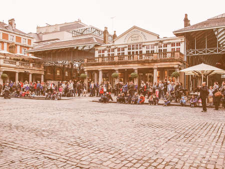 covent: LONDON, ENGLAND, UK - OCTOBER 23: Tourists visiting the world famous Covent Garden on October 23, 2013 in London, England, UK vintage