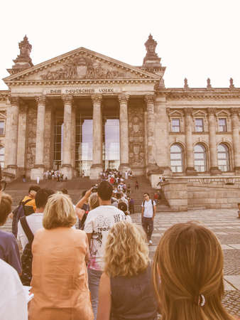 queueing: BERLIN, GERMANY - AUGUST 7: People queueing to visit the Reichstag (The German Parliament) in Berlin Germany on August 7, 2009 in Berlin, Germany vintage Editorial