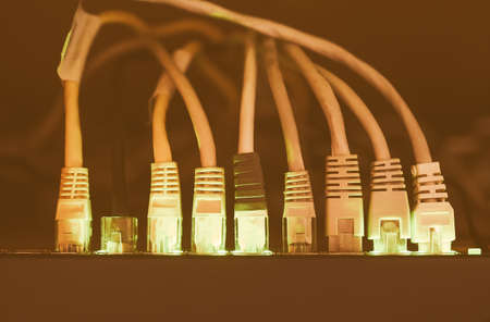 gigabit: Switch and ethernet cables used in networking vintage