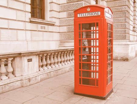 red telephone: Traditional Red Telephone Box in London UK vintage Stock Photo