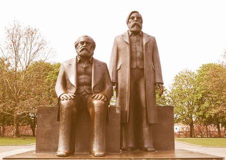 marx: Marx and Engels statue in Marx-Engels-Forum, Alexanderplatz, Berlin vintage