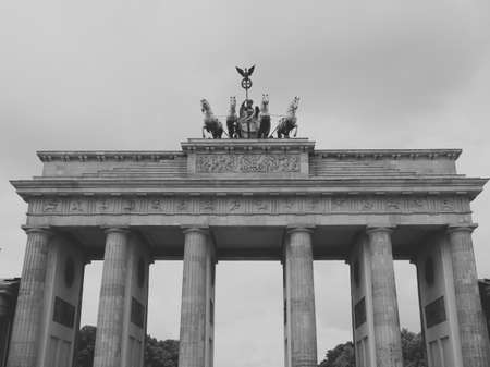 brandenburg gate: Brandenburger Tor Brandenburg Gate famous landmark in Berlin Germany - faded vintage black and white effect Stock Photo