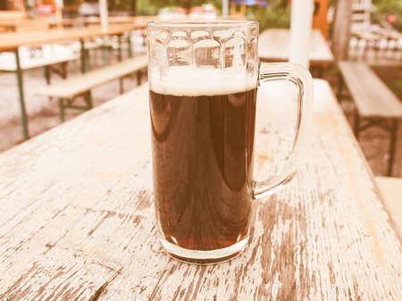 biergarten: Vintage looking A glass of German dark beer