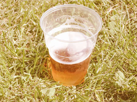 pint: Pint of beer amidst a meadow grass vintage