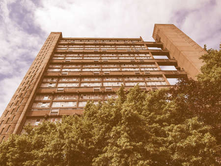 hamlets: LONDON, ENGLAND, UK - JUNE 20, 2011: The Balfron Tower designed by Erno Goldfinger in 1963 is a Grade II listed masterpiece of new brutalist architecture vintage