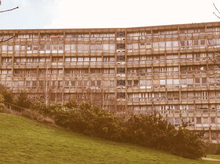 late 60s: LONDON, ENGLAND, UK - MARCH 05, 2009: The Robin Hood Gardens housing estate designed in late sixties by Alison and Peter Smithson is a masterpiece of new brutalist architecture vintage