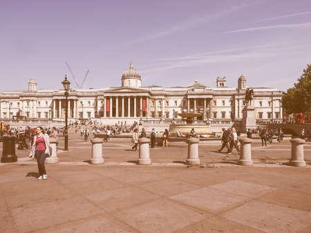 trafalgar: LONDON, UK - JUNE 11, 2015: Tourists visiting Trafalgar Square in front of the National Gallery vintage