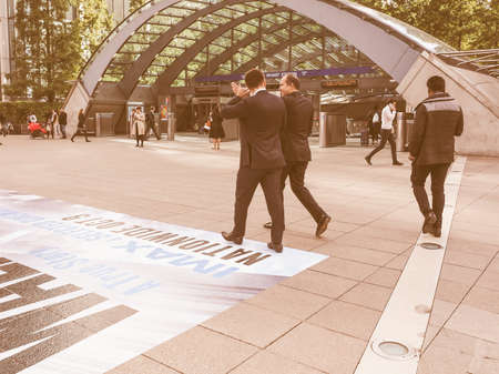 serves: LONDON, UK - SEPTEMBER 29, 2015: The Canary Wharf tube station serves the largest business district in the United Kingdom vintage