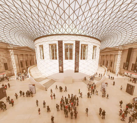 foster: LONDON, UK - SEPTEMBER 28, 2015: Tourists in the Great Court at the British Museum designed by architect Lord Norman Foster opened in year 2000 seen with fisheye lens vintage Editorial