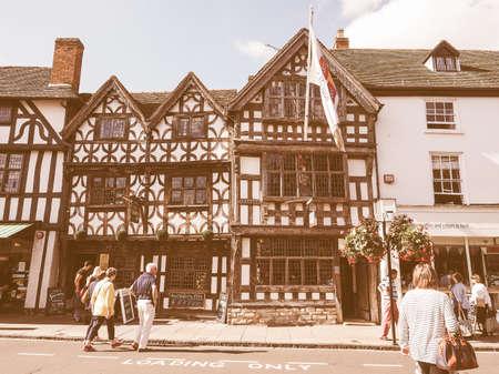 elizabethan: STRATFORD UPON AVON, UK - SEPTEMBER 26, 2015: Harvard House is the most elaborately decorated Elizabethan house build during Shakespeare lifetime vintage