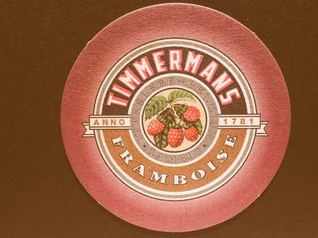 belgie: BRUSSELS, BELGIUM - DECEMBER 11, 2014: Beermat of Belgian beer Timmermans Framboise vintage