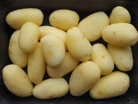 tuberosum: Potatoes (Solanum tuberosum) vegetables vegetarian food in a tub Stock Photo