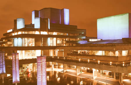 sixties: Night view of the Royal National Theatre in London, iconic sixties new brutalist architecture vintage