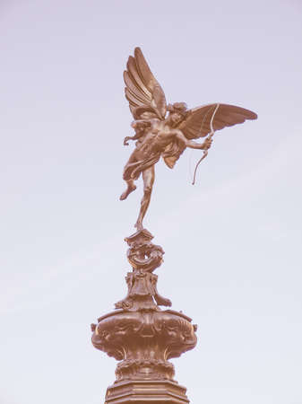 piccadilly: Piccadilly Circus with statue of Anteros aka Eros in London, UK vintage