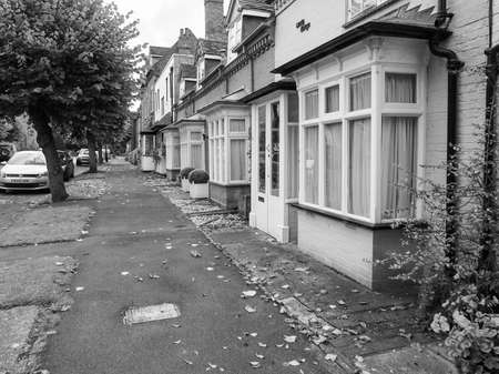 townhouses: TANWORTH IN ARDEN, UK - CIRCA SEPTEMBER 2015: A row of typically British terraced houses aka townhouses in black and white Editorial