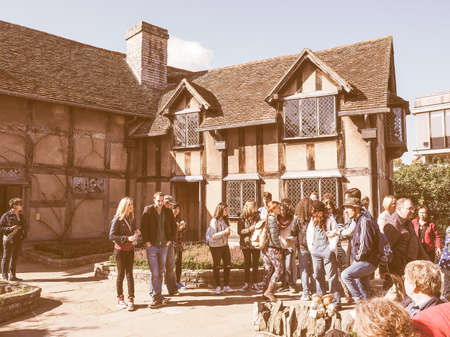 birthplace: STRATFORD UPON AVON, UK - SEPTEMBER 26, 2015: Tourists in front of William Shakespeare birthplace vintage