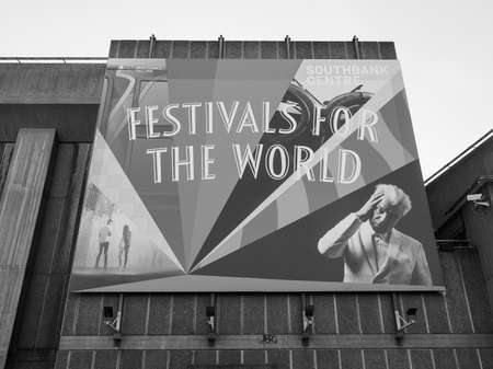 southbank: LONDON, UK - SEPTEMBER 28, 2015: Festivals for the world billboard with David Byrne at Southbank Centre in black and white