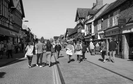 william shakespeare: STRATFORD UPON AVON, UK - SEPTEMBER 26, 2015: Tourists visiting the city of Stratford, birthplace of William Shakespeare in black and white