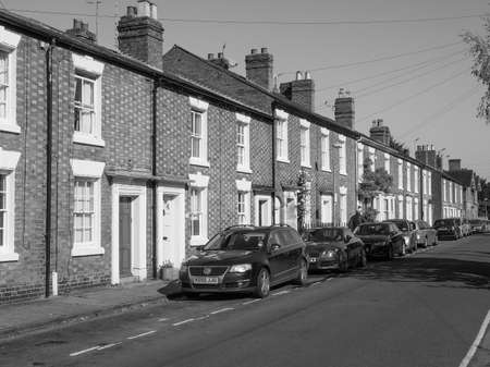 typically british: STRATFORD UPON AVON, UK - SEPTEMBER 26, 2015: A row of typically British terraced houses aka townhouse in black and white