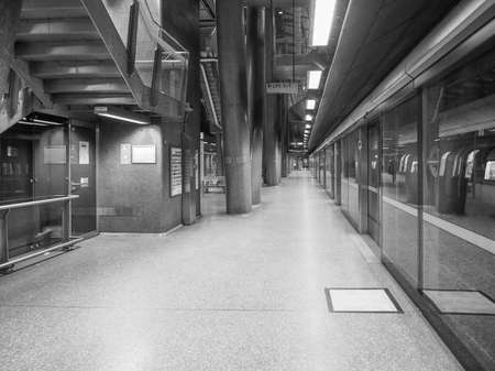 tube station: LONDON, UK - SEPTEMBER 29, 2015: North Greenwich London Underground tube station in black and white Editorial