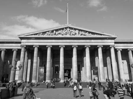 british museum: LONDON, UK - SEPTEMBER 28, 2015: Tourists visiting the British Museum in black and white Editorial
