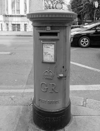 royal mail: LONDON, UK - SEPTEMBER 27, 2015: Royal Mail mailbox for mail collection in black and white