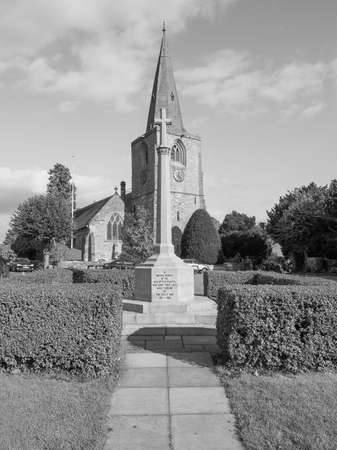 saint nick: TANWORTH IN ARDEN, UK - SEPTEMBER 25, 2015: The Village Green with St Mary Magdalene church and war memorial in black and white Editorial