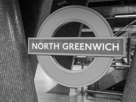 tube station: LONDON, UK - SEPTEMBER 29, 2015: London Underground sign at North Greenwich tube station in black and white Editorial