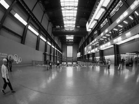public space: LONDON, UK - SEPTEMBER 28, 2015: The Turbine Hall once housed the electricity generators of the power station now a public space part of Tate Modern art gallery in South Bank seen with fisheye lens in black and white Editorial