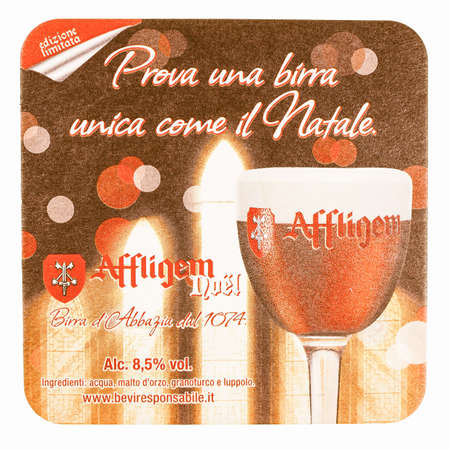 belgie: MILAN, ITALY - MARCH 15, 2015: Beermat of special Christmas Belgian beer Affligem isolated over white background vintage Editorial