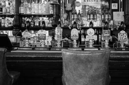 draught: LONDON, UK - CIRCA SEPTEMBER 2015: Draught cask beers in a traditional English Pub - frontal view in black and white Editorial