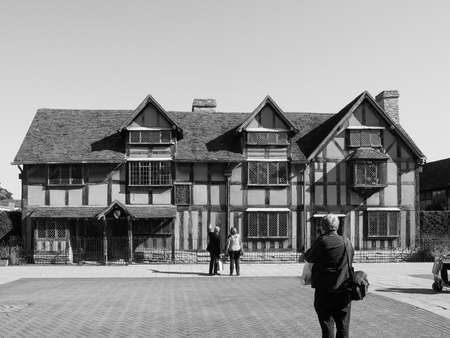 william shakespeare: STRATFORD UPON AVON, UK - SEPTEMBER 26, 2015: Tourists in front of William Shakespeare birthplace in black and white
