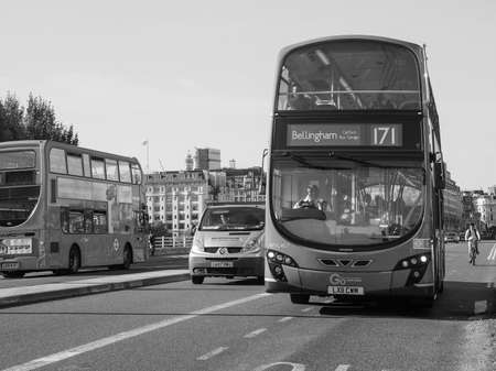 double decker: LONDON, UK - SEPTEMBER 28, 2015: Red double decker bus for public transport in central London in black and white