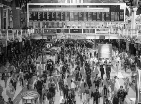 lapse: LONDON, UK - SEPTEMBER 28, 2015: Travellers at Liverpool Street Station multi exposure time lapse in black and white