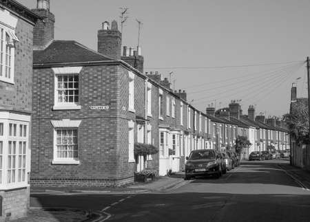 typically british: STRATFORD UPON AVON, UK - SEPTEMBER 26, 2015: A row of typically British terraced houses aka townhouses in black and white Editorial