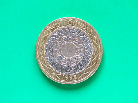 pounds: British Pound coin currency of the United Kingdom - Two Pounds