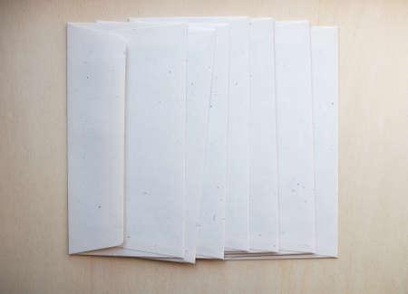 letter envelopes: Letter envelopes for mail postage on wooden table Stock Photo