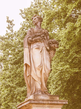 representing: Statue of woman representing fruit in Park Sanssouci Potsdam Berlin Germany vintage Stock Photo