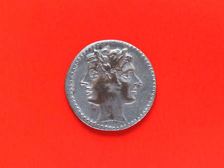 janus: Ancient Roman coin with Janus over red background