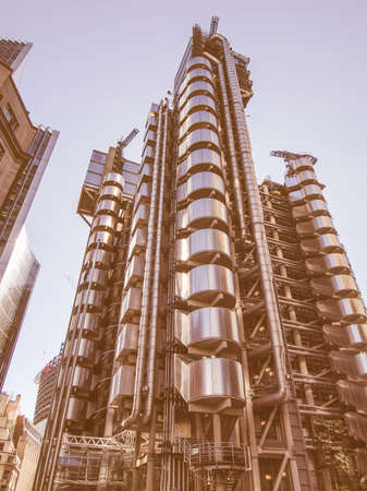 lloyd's of london: LONDON, ENGLAND, UK - SEPTEMBER 07, 2012: Iconic high tech skyscraper designed by architect Richard Rogers in 1986 for the Lloyds of London and now Grade I listed vintage Editorial