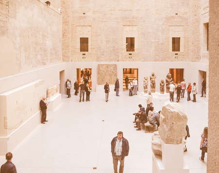 neues: BERLIN, GERMANY - CIRCA APRIL, 2010: Tourists visiting the Neues Museum meaning New Museum designed by British architect David Chipperfield vintage Editorial