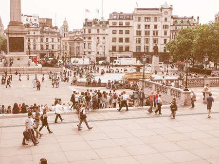 trafalgar: LONDON, UK - JUNE 12, 2015: Tourists visiting Trafalgar Square vintage