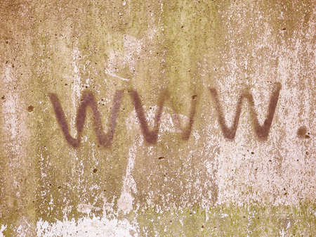 url: Www internet address url written with black paint on a grunge gray concrete wall with green moss vintage