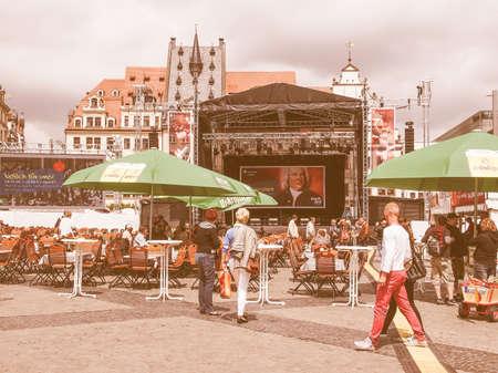 biergarten: LEIPZIG, GERMANY - JUNE 14, 2014: People at the Bachfest annual summer music festival celebrating baroque musician Johann Sebastian Bach in his town vintage