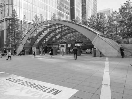 serves: LONDON, UK - SEPTEMBER 29, 2015: The Canary Wharf tube station serves the largest business district in the United Kingdom in black and white