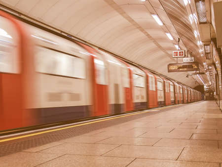 19 year old: LONDON, ENGLAND, UK - JUNE 19: Train departing from an underground Tube Station on June 19, 2011 in London, England, UK vintage