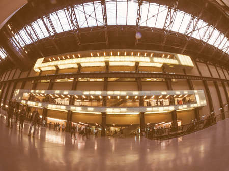 south space: LONDON, UK - SEPTEMBER 28, 2015: The Turbine Hall once housed the electricity generators of the power station now a public space part of Tate Modern art gallery in South Bank seen with fisheye lens vintage