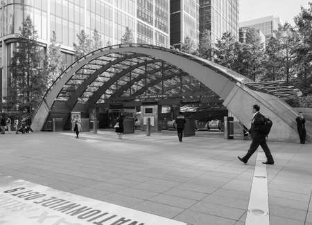 tube station: LONDON, UK - SEPTEMBER 29, 2015: The Canary Wharf tube station serves the largest business district in the United Kingdom in black and white