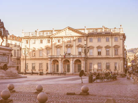 seated: TURIN, ITALY - OCTOBER 22, 2014: People seated in front of Conservatorio Giuseppe Verdi music school vintage Editorial