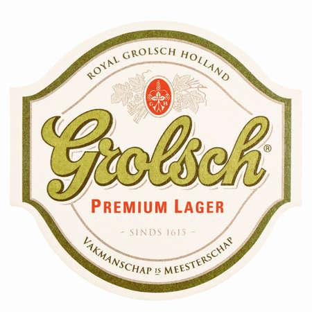 nederland: AMSTERDAM, NETHERLANDS - MARCH 15, 2015: Grolsch beer beermat isolated over white background vintage